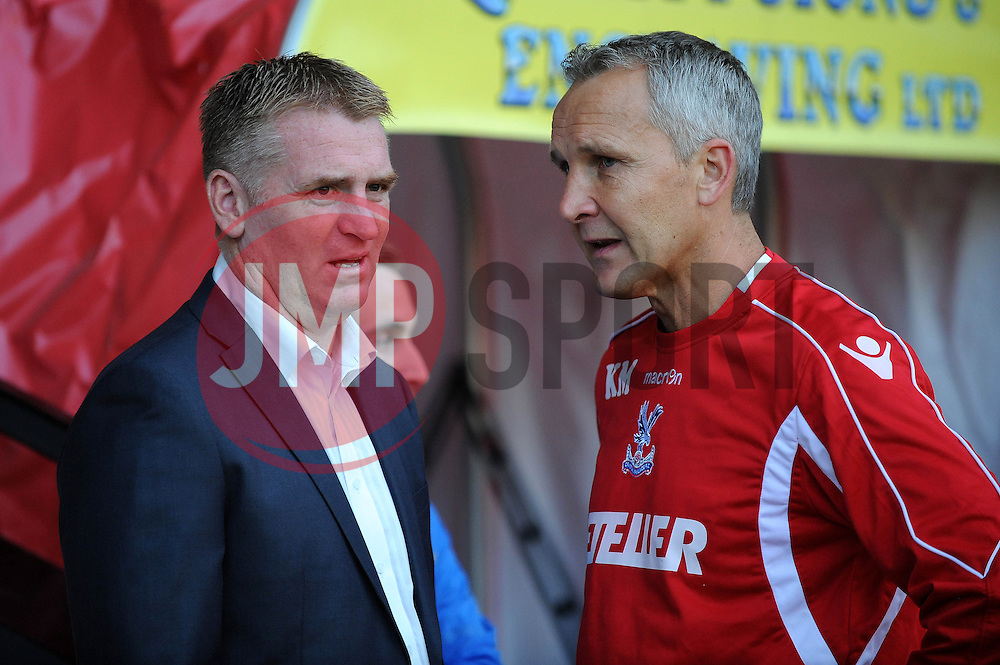 Walsall Manager, Dean Smith and Crystal Palace Manager, Keith Millen exchange words prior to kick off - Photo mandatory by-line: Dougie Allward/JMP - Mobile: 07966 386802 26/08/2014 - SPORT - FOOTBALL - Walsall - Bescot Stadium - Walsall v Crystal Palace - Capital One Cup