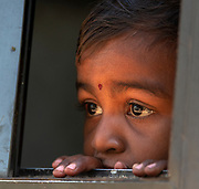 Young Indian boy in bus window.