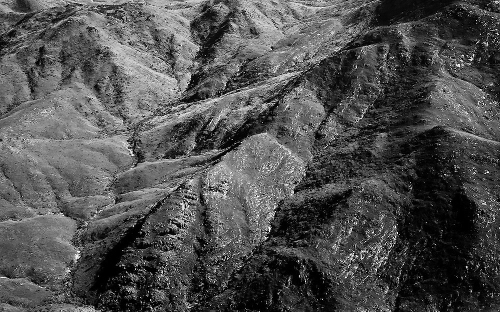 Aerial BW of hills and valleys in the West MacDonnell ranges, Central Australia
