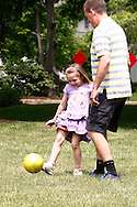 Father Christian Taylor of Dayton watches Lauren, 5 at Shafor Park in Oakwood, Sunday, June 9, 2013.