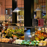Inside the Grand Central Market in Los Angeles, California <br /> When you walk through the door of the Grand Central Market you&rsquo;ll immediately hear the buzz of people bargaining with produce vendors, ordering lunch at a deli counter, or talking with friends as they navigate the narrow aisles.  Since 1917, these 30,000 square feet of bustling commerce have been housed in the Homer Laughlin Building.  It was built in 1896 and, during the 1920s, its famous tenant was Frank Lloyd Wright.