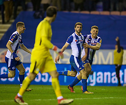 WIGAN, ENGLAND - Monday, February 19, 2018: Wigan Athletic's Will Grigg celebrates scoring the winning goal with team-mate Max Power during 1-0 victory in the FA Cup 5th Round match between Wigan Athletic FC and Manchester City FC at the DW Stadium. (Pic by David Rawcliffe/Propaganda)