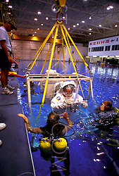 Stock photo of a man being lowered into the  pool at the NASA Neutral Buoyancy Lab in Houston Texas