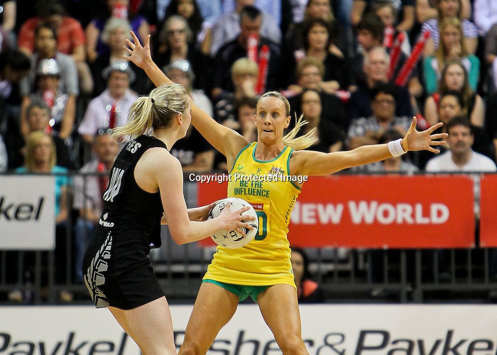 Australia's Renae Hallinan looks to block the view of New Zealand's Camilla (Millie) Lees during the New World Quad Series - Silver Ferns v Australian Diamonds, 1 November 2012.  Photo:  Bruce Lim / www.photosport.co.nz