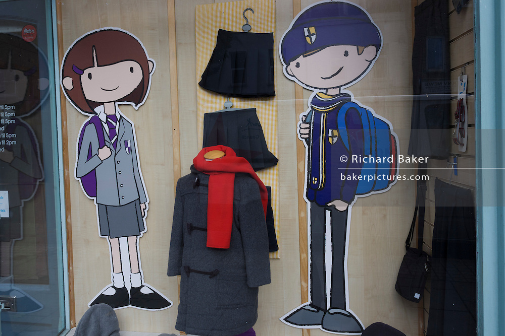 Local London school uniforms and cartoon characters on display in a Dulwich shop window.