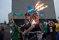 A musician with flaming bagpipes leading a spontaneous march to mobilise support for a pro-independence vote in the Craigmillar district of Edinburgh on the day of the independence referendum. Yes Scotland were campaigning for the country to leave the United Kingdom, whilst Better Together were campaigning for Scotland to remain in the UK. On the 18th of September 2014, the people of Scotland voted in a referendum to decide whether the country's union with England should continue or Scotland should become an independent nation once again and leave the United Kingdom.