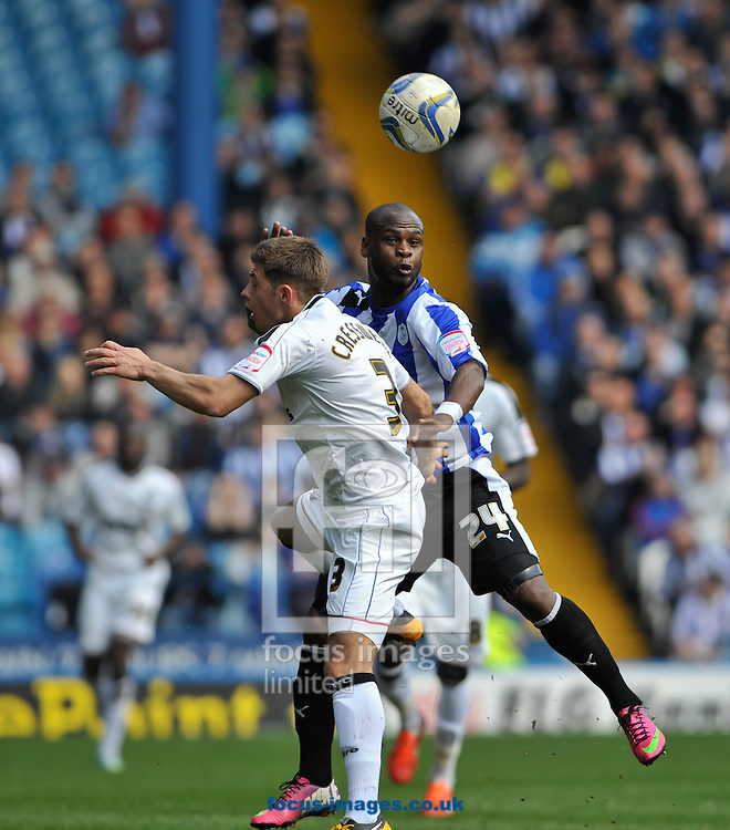 Picture by Richard Land/Focus Images Ltd +44 7713 507003.20/04/2013.Leroy Lita of Sheffield Wednesday and Aaron Cresswell of Ipswich Town during the npower Championship match at Hillsborough, Sheffield.