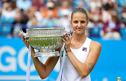 Czech Republic's Karolina Pliskova lifts the trophy after winning against Denmark's Caroline Wozniacki in the Women's Singles Final during day nine of the AEGON International at Devonshire Park, Eastbourne.