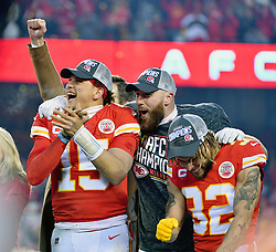 Jan 19, 2020; Kansas City, Missouri, USA; Kansas City Chiefs quarterback Patrick Mahomes (15) and tight end Travis Kelce (87) and strong safety Tyrann Mathieu (32) celebrate on stage after the AFC Championship Game against the Tennessee Titans at Arrowhead Stadium. Mandatory Credit: Denny Medley-USA TODAY Sports