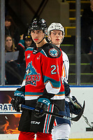 KELOWNA, BC - OCTOBER 12: Dillon Hamaliuk #22 of the Kelowna Rockets stands on the ice in front of Ryley Appelt #23 of the Kamloops Blazers at Prospera Place on October 12, 2019 in Kelowna, Canada. Hamaliuk was selected by the San Jose Sharks in the 2019 NHL entry draft. (Photo by Marissa Baecker/Shoot the Breeze)