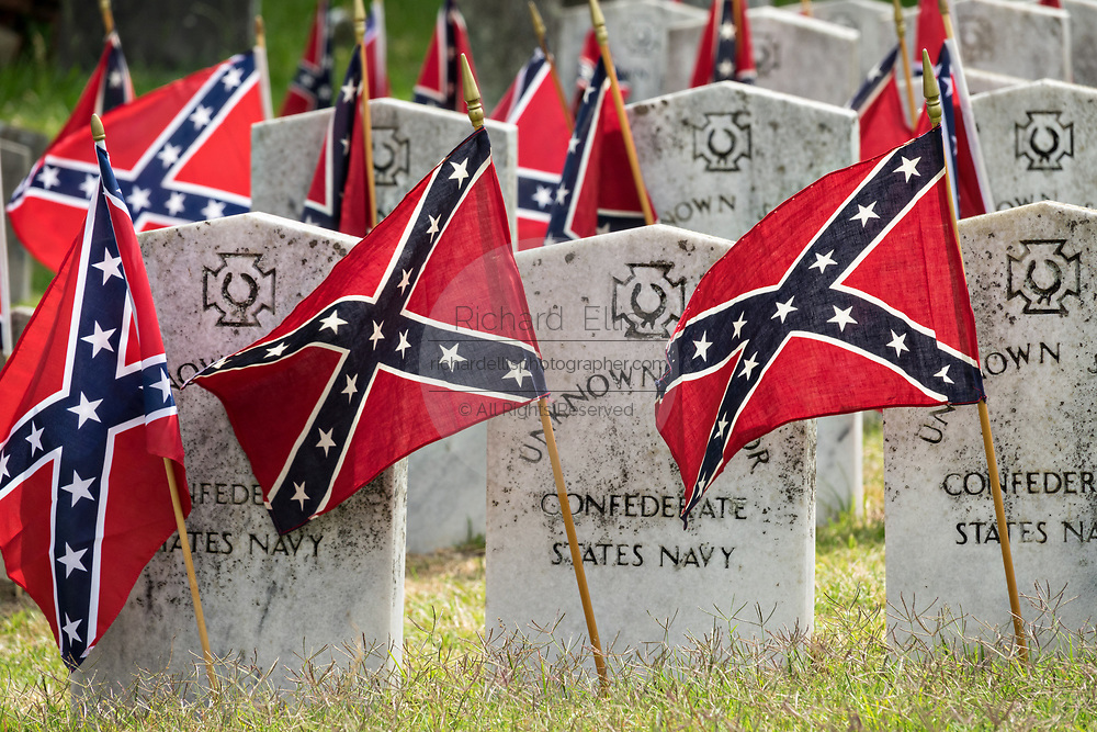 Confederate battle flags mark the tombs of Confederate soldiers and sailors during Confederate Memorial Day at Magnolia Cemetery May 11, 2019 in Charleston, South Carolina. Confederate memorial day continues to be an official state holiday in South Carolina where the American Civil War began.