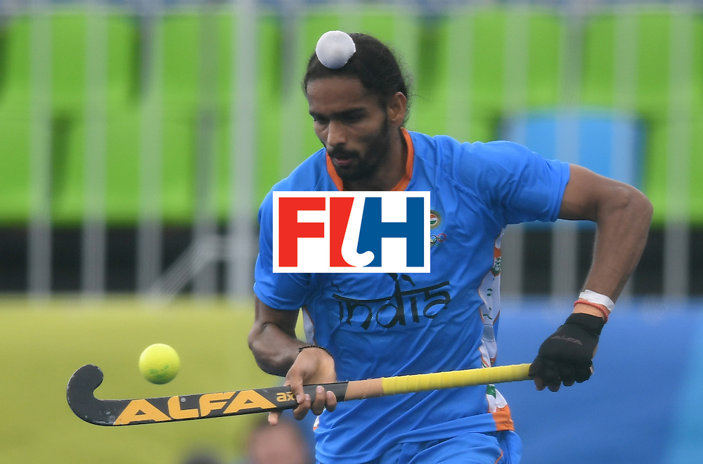 India's Akashdeep Singh controls the ball during the men's field hockey Germany vs India match of the Rio 2016 Olympics Games at the Olympic Hockey Centre in Rio de Janeiro on August, 8 2016. / AFP / MANAN VATSYAYANA        (Photo credit should read MANAN VATSYAYANA/AFP/Getty Images)