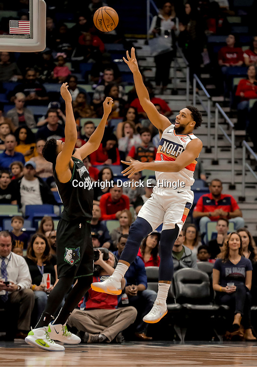 Dec 31, 2018; New Orleans, LA, USA; New Orleans Pelicans center Jahlil Okafor (8) shoots over Minnesota Timberwolves center Karl-Anthony Towns (32) during the first quarter at the Smoothie King Center. Mandatory Credit: Derick E. Hingle-USA TODAY Sports