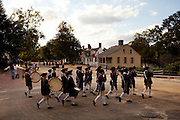 Williamsburg, VA - October 5, 2010: Members of the Colonial Williamsburg Fifes and Drums mingle after a performance in Colonial Williamsburg, Virginia on Tuesday, October 5, 2010.<br /> <br /> (Photo by Matt Eich/LUCEO for The Washington Post)