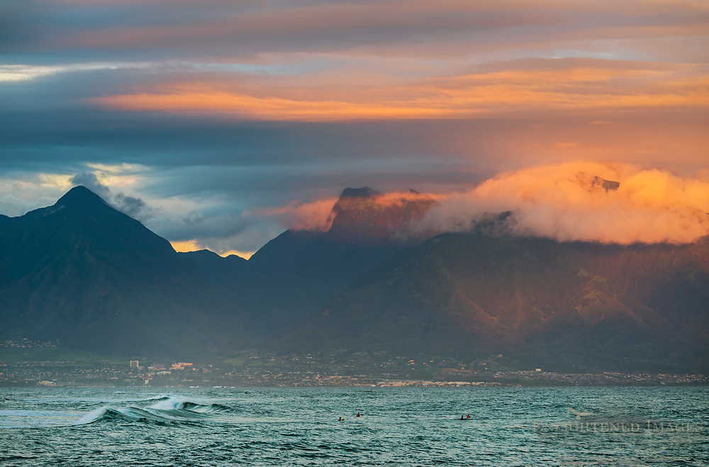 Morning light over surfers along the North Shore at Ho'okipa Beach, Maui, Hawaii