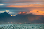 Morning light over surfers along the North Shore at Ho'okipa Beach, Maui, Hawaii