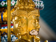 22 AUGUST 2015 - BANGKOK, THAILAND: The face of the Brahma statue in Erawan Shrine was damaged in the terrorist attack at the shrine on August 17. Erawan Shrine in Bangkok reopened Wednesday, August 19, after more than 20 people were killed and more than 100 injured in a bombing at the shrine Monday, August 17, 2015. The shrine is a popular tourist attraction in the center of Bangkok's high end shopping district and is an important religious site for Thais. No one has claimed responsibility for the bombing.             PHOTO BY JACK KURTZ