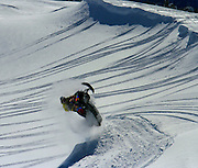 Tim Hoff aims his Skidoo Vertical off a cornice