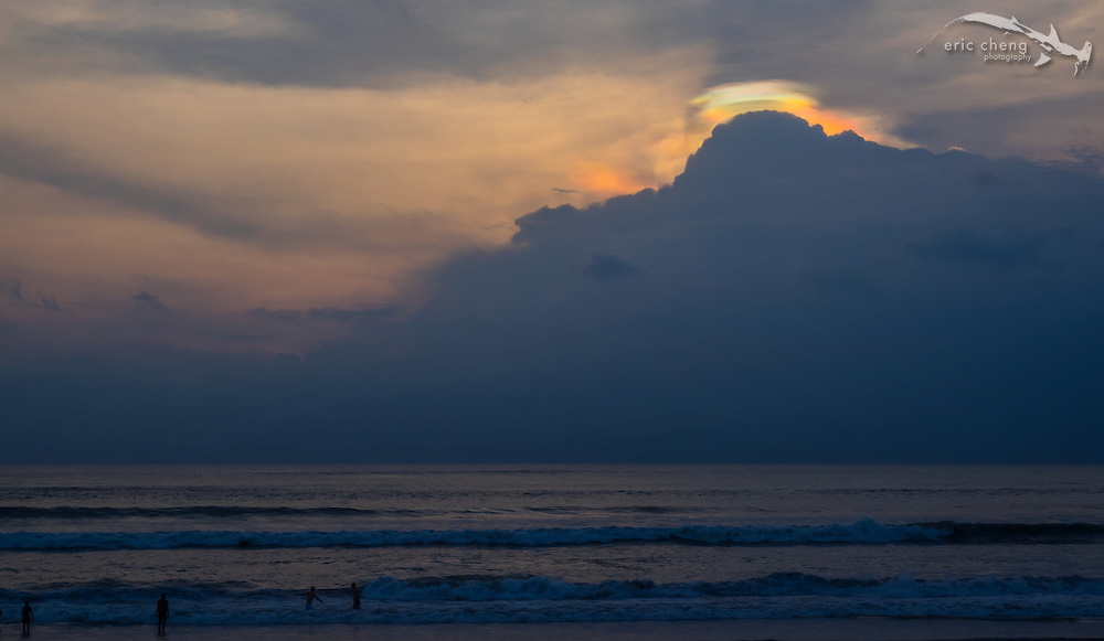 Strange colors play in the clouds during a dramatic sunset in Seminyak, Indonesia.