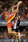 GOLD COAST, AUSTRALIA - JULY 30:  Rory Thompson of the Suns maks the ball over Leigh Montagna of the Saints during the round 19 AFL match between the Gold Coast Suns and the St Kilda Saints at Metricon Stadium on July 30, 2011 in Gold Coast, Australia.  (Photo by Matt Roberts/Getty Images)