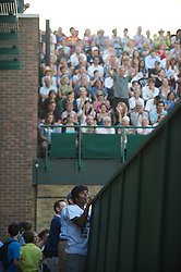 LONDON, ENGLAND - Wednesday, June 23, 2010: Fans clamber for a vantage point to watch the record-breaking marathon Gentlemen's Singles 1st Round match, which ended due to bad light at 59-59 in the fifth set, on day three of the Wimbledon Lawn Tennis Championships at the All England Lawn Tennis and Croquet Club. (Pic by David Rawcliffe/Propaganda)