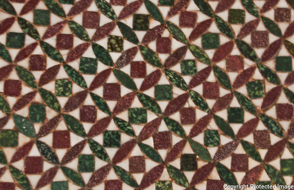 Detail of a patterned stone mosaic floor in a palazzo in Venice, Italy.