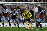 Mark Sykes (18) of Oxford United and Robert Snodgrass (11) of West Ham United and Arthur Masuaku (26) of West Ham United during the EFL Cup match between Oxford United and West Ham United at the Kassam Stadium, Oxford, England on 25 September 2019.