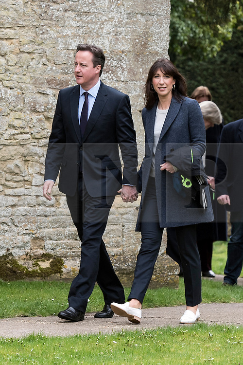 © Licensed to London News Pictures. 05/04/2015. Chadlington, Oxfordshire. David and Samantha Cameron attend the Easter service at Chadlington Church and then visit the grave of their son Ivan. Photo credit : MARK HEMSWORTH/LNP