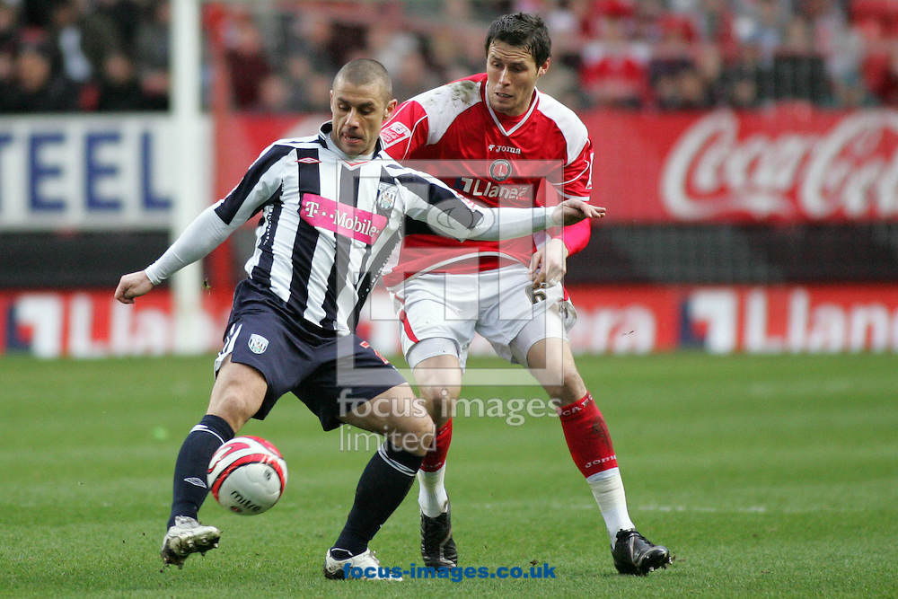 London - Friday, March 21st, 2008: Patrick McCarthy (R) of Charlton Athletic and Kevin Phillips (L) of West Bromwich Albion during the Coca Cola Championship match at The Valley, London. (Pic by Mark Chapman/Focus Images)