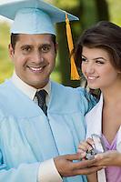 Wife Giving Man Graduation Gift