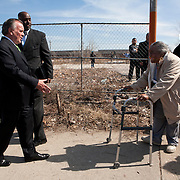 Mayor Richard Daley is greeted by a south side resident at a ground breaking ceremony for a Walmart store.  Photography by Jose More