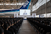Newly hired employees listen the speech of Holdings Inc. President and Chief Executive Officer Shinya Katanozaka   during the welcome ceremony of ANA Holdings Inc. at the company's hanger on April 1, 2017 in Tokyo, Japan. Japanese airlines ANA Holdings welcomed 2,800 new employees, the largest number to date for the company. As the majority of Japanese start their career on April 1st after graduating from schools in February or March, it is a custom for large Japanese corporations to hold mass welcoming ceremonies for their new employees. 1/04/2017-Tokyo, JAPAN