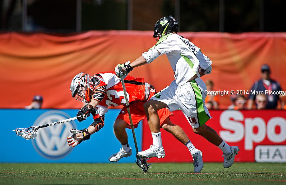 SHOT 8/16/14 3:33:52 PM - The Denver Outlaws Drew Snider #23 gets hit by the New York Lizards Kyle Hartzell #81 during their MLL Semifinals matchup at Peter Barton Lacrosse Stadium on the University of Denver campus in Denver, Co. Saturday. The Denver Outlaws won the game 14-13 to advance. (Photo by Marc Piscotty / © 2014)