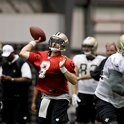 July 27, 2012; Metairie, LA, USA; New Orleans Saints quarterback Drew Brees (9) during training camp at the team's indoor practice facility. Mandatory Credit: Derick E. Hingle-US PRESSWIRE