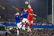 Swansea City defender Alfie Mawson (6) flicks the ball on ahead of Everton defender Ashley Williams (5) and Everton striker Wayne Rooney (10)  during the Premier League match between Everton and Swansea City at Goodison Park, Liverpool, England on 18 December 2017. Photo by Simon Davies.