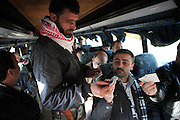 Soldiers of the Free Syrian Army controling passports at a checkpoint south of the town of Idlib, Province of Idlib, Syria.