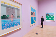 Peter Getting out of Nicks Pool, 1966, A Bigger Splash, 1967, and a Lawn Being Sprinkled, 1967  - David Hockney, a major new retrospective, at Tate Britain's. It includes more than 200 works and celebrates Hockney's achievement in painting, drawing, print, photography and video. As he approaches his 80th birthday, this exhibition offers an unprecedented overview of the artist's 60-year career. It runs from 9 Feb to 29 May 2017. London 06 Feb 2017.
