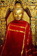 Golden statue inside Inle Lake monastery