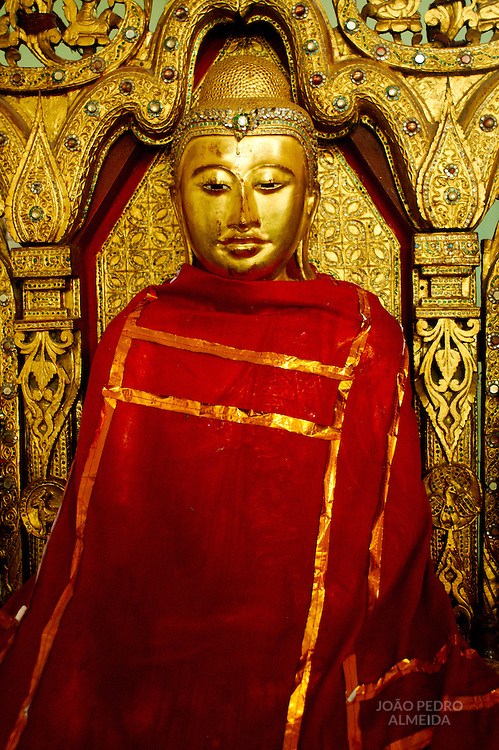 Golden statue inside Inle Lake monastery