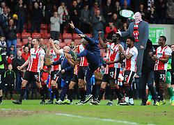 Cheltenham Town players and staff celebrate after the final whistle - Mandatory by-line: Nizaam Jones/JMP- 29/04/2017 - FOOTBALL - LCI Rail Stadium - Cheltenham, England - Cheltenham Town v Hartlepool United - Sky Bet League Two