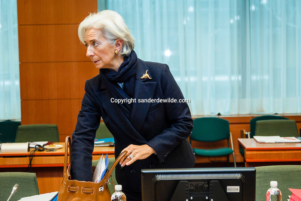 International Monetary Fund (IMF) Managing Director Christine Lagarde with one hand in handbag and with golden broche from Venice, before an Eurogroup Council meeting on February 11, 2013 at the European Union Headquarters in Brussels. Dijsselbloem holds his first eurozone meeting today, with Cyprus and Greece on the agenda.