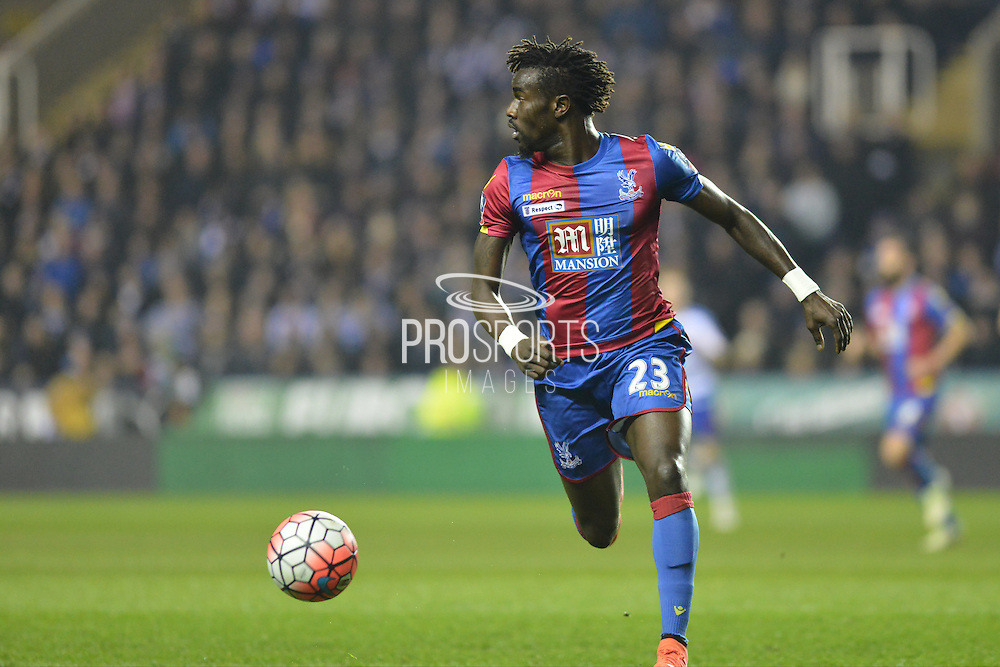 Crystal Palace defender Pape Souare looks to clear the ball during the The FA Cup Quarter Final match between Reading and Crystal Palace at the Madejski Stadium, Reading, England on 11 March 2016. Photo by Mark Davies.