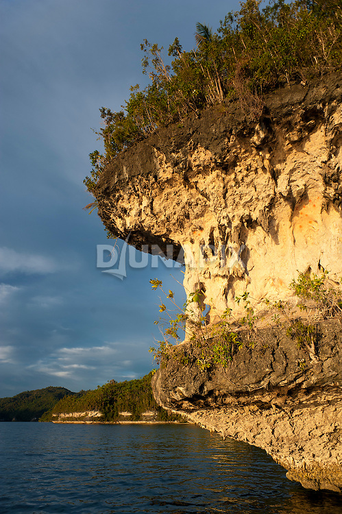Distinctive wave cut ledges that host prehistoric rock art near Mai Mai Village, Namatota Strait, near Kaimana, Papua.