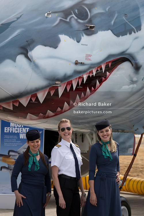 A crew beneath the shark's teeth of an Embraer E190-E2 at the Farnborough Airshow, on 16th July 2018, in Farnborough, England. (Photo by Richard Baker / In Pictures via Getty Images)