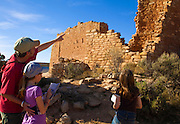 350310-1004 ~ Copyright: George H. H. Huey ~ A family along the Little Ruin Canyon Trail, Hovenweep National Monument, Utah/Colorado.