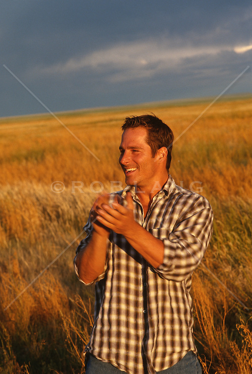 Good looking man enjoying life while outside in a field in New Mexico