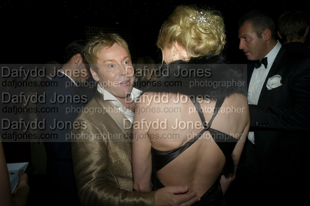 ROYSTON BLYTHE; LAUREN MCCALISTER, Grey Goose Winter Ball to Benefit the Elton John AIDS Foundation. Battersea park. London. 29 October 2011. <br /> <br />  , -DO NOT ARCHIVE-&copy; Copyright Photograph by Dafydd Jones. 248 Clapham Rd. London SW9 0PZ. Tel 0207 820 0771. www.dafjones.com.