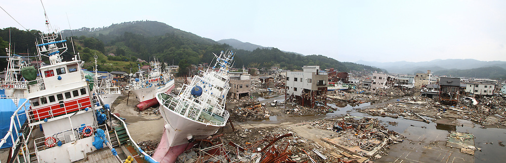 June 13, 2011; Kesennuma, Miyagi Pref., Japan - Fishing boats lie scattered like toys on dry land a quarter-mile from the ocean after a tsunami carried them inland after the March 11, 2011 Great Tohoku Earthquake and Tsunami devastated the Northeast coast of Japan.