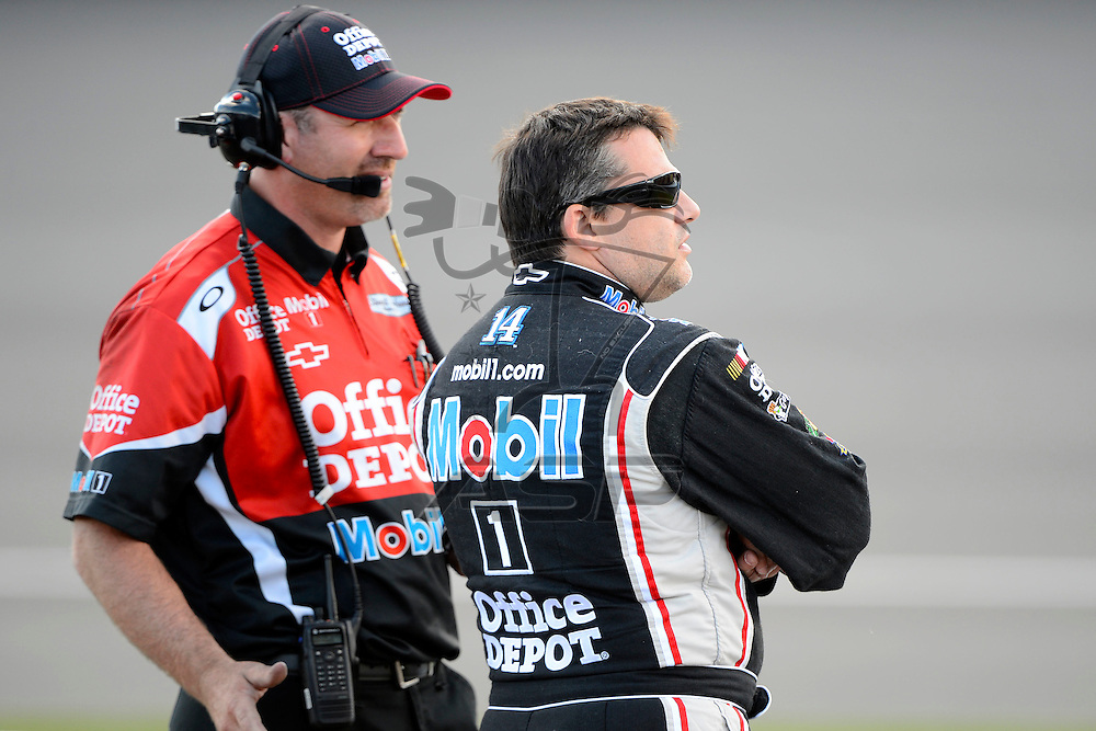Brooklyn, MI  - Aug 17, 2012: Tony Stewart (14) stands on pit row during qualifying for the Pure Michigan 400 at Michigan International Speedway in Brooklyn, MI.