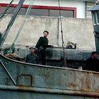 SHINIUJU, OCTOBER-26: workers on a ship in the  China-bound port, Shiniuju,October 26,2006.